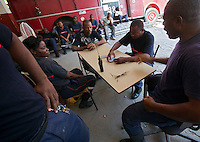 Firefighters sit and play cards at the Port-au-Prince, Haiti fire station. The building was heavily damaged in the January 12 earthquake and has been deemed uninhabitable and marked for demolition, though no one can say when that may be. There are no plans yet for relocation. A few dozen under-equipped firefighters are tasked with providing fire service to a damaged city of over two million people.