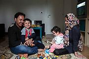 30 Gennaio 2016, Savona, Italia - Farid Kazemi, 33 anni, con la moglie Fatima 23 anni e i figli Benjamin 3 anni e Farnaz di anni 1.