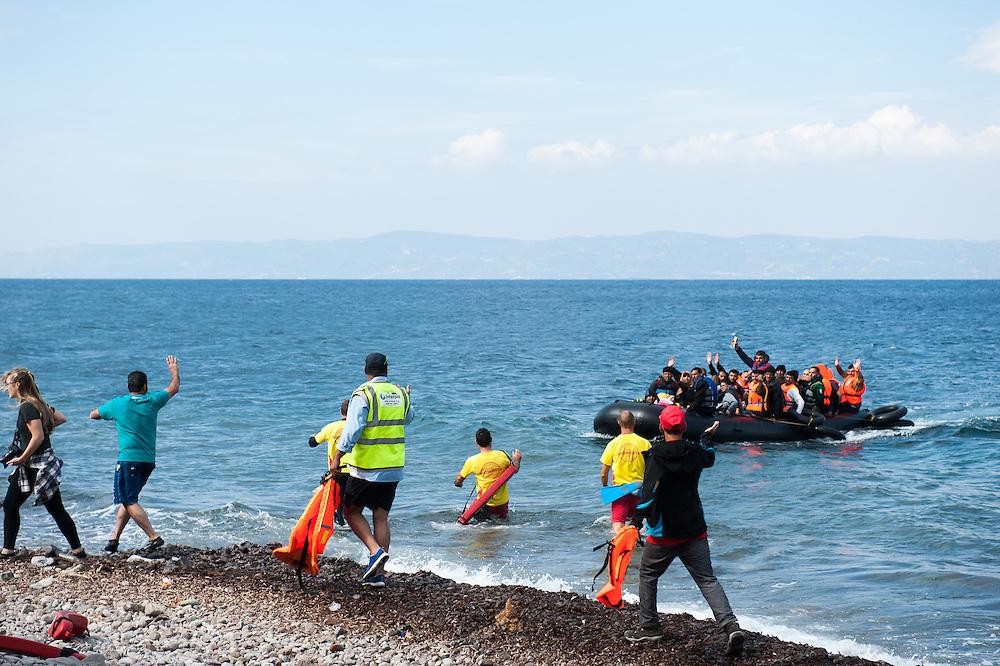 A dinghy with refugees is landing at e beach of Skala Sykamias, Lesvos, Greece.