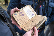 Soldiers log and identy papers held by a person during the ww1 centenary armistice memorial commeration