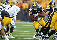 September 17, 2011: Iowa Hawkeyes running back Marcus Coker (34) looks for running room during the first half of the game between the Iowa Hawkeyes and the Pittsburgh Panthers at Kinnick Stadium in Iowa City, Iowa on Saturday, September 17, 2011. Iowa defeated Pittsburgh 31-27.