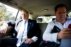 London Mayor Boris Johnson working in his car in Delhi with his communications Director Will Walden, on Day 2 of his 6 day tour, where he will be trying to persuade Indian businesses to invest in London, Monday November 26, 2012. Photo by Andrew Parsons / i-Images