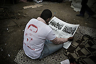 """EGYPT, Cairo : Egyptian anti-government demonstrators sits at Cairo's Tahrir square on February 4, 2011 as protesters were preparing to mass on the 11th day for sweeping """"departure day"""" demonstrations to force President Hosni Mubarak to quit.© ALESSIO ROMENZI"""
