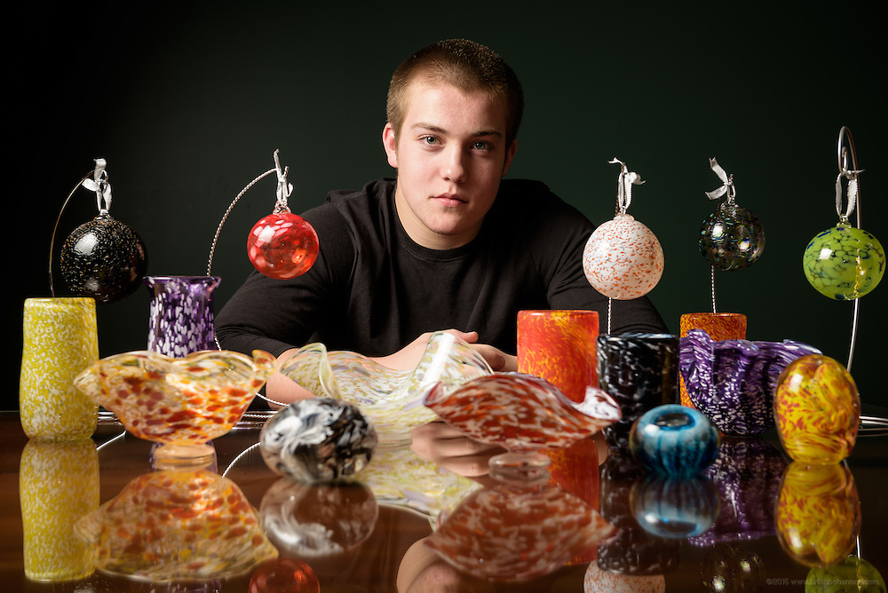 Daniel Kimbell, 14, a freshman at Oldham County High School where he wrestles and plays football, is shown at home in Crestwood with items he made while blowing glass at Flame Run Glass Studio and Gallery in Louisville. Nov. 24, 2014