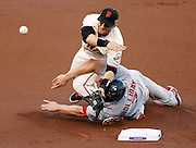 Giants' third baseman Marco Scutaro grimaces after Cardinals' left fielder Matt Holliday slides into him on a fielder's choice out in the first inning during game 2 of the NLCS on Monday, Oct. 15, 2012 at AT&T Park in San Francisco, Calif.