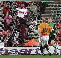 Photo: Lee Earle/Sportsbeat Images.<br /> Southampton v Hull City. Coca Cola Championship. 08/12/2007. Hull keeper Boaz Myhill is beaten by Southampton's Stern John (L) as he heads home their second.