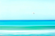 Minimalistic seascape with a tiny sailboat on the horizon - manipulated photograph