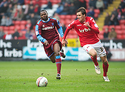 LONDON, ENGLAND - Saturday, March 5, 2011: Tranmere Rovers' Max Power and Charlton Athletic's Carl Jenkinson in action during the Football League One match at The Valley. (Photo by Gareth Davies/Propaganda)