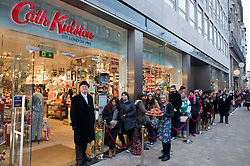 © Licensed to London News Pictures.05/12/2013. London, UK. First customers wait for the opening of the new Cath Kidston store at 180 Piccadilly, London. The new store is the largest Cath Kidston store in the world and  has over 20,000 products, including new ranges and services..Photo credit : Peter Kollanyi/LNP