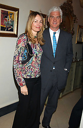 MR & MRS STEVEN LUSSIER, she is the daughter of Anthony Oppenheimer  at a Conservative Party Reception for the Art held at 24 Thurloe Square, Lndon SW7 on 5th April 2005.<br />