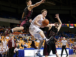 Wheeling Central forward Adam Campbell (44) gets out of control as he goes up against two Williamstown defenders during a semi final round game at the Charleston Civic Center.