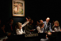 Auctioneers, Christie's, London. On the wall: Stanley Spencer, (English painter, 1891-1959) Scarecrow, Cookham 1934