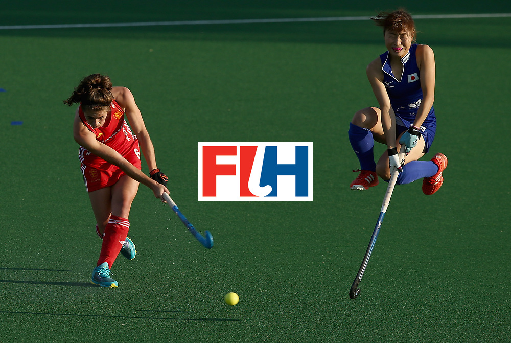 JOHANNESBURG, SOUTH AFRICA - JULY 12: Anna Toman of England passes the ball under pressure from Yuri Nagai of Japan during day 3 of the FIH Hockey World League Semi Finals Pool A match between Japan and England at Wits University on July 12, 2017 in Johannesburg, South Africa. (Photo by Jan Kruger/Getty Images for FIH)