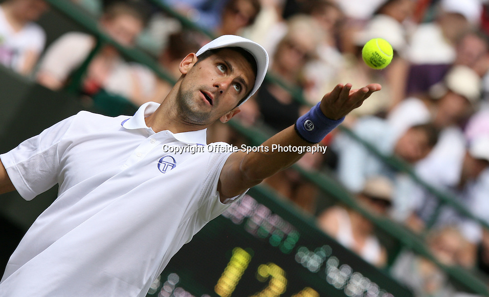 23/06/2011 - Wimbledon (Day 4) - Kevin Anderson vs. Novak Djokovic - Novak Djokovic tosses the ball up to serve - Photo: Simon Stacpoole / Offside.