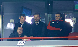 LIVERPOOL, ENGLAND - Wednesday, January 20, 2016: Liverpool's James Milner, captain Jordan Henderson and Adam Lallana watch from Steven Gerrard's executive box during the FA Cup 3rd Round Replay match against Exeter City at Anfield. (Pic by David Rawcliffe/Propaganda)