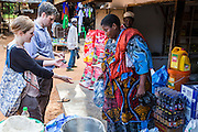 VSO volunteers Dr Siobhan Neville and Dr Peter O'Reilly out shopping  for food in the market of Nyangao,  Lindi Region, Tanzania.