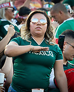 A fan does a salute for the Mexican national anthem before the game between Mexico and Cuba in a CONCACAF Gold Cup soccer match in Pasadena, Calif., Saturday, June 15, 2019. Mexico defeated Cuba 7-0. (Ed Ruvalcaba/Image of Sport)