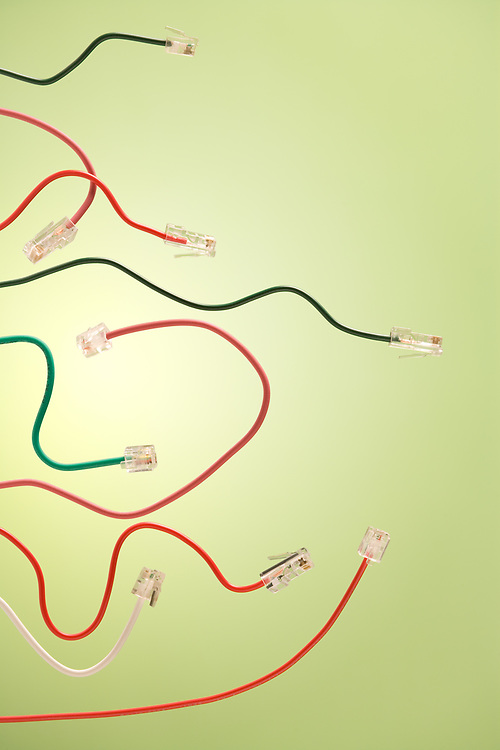 Computer net cables and telephone jack on a green background