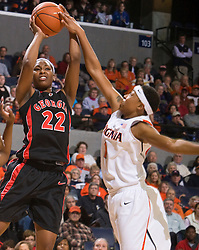 Virginia forward Lyndra Littles (1) blocks a jump shot by Georgia guard Christy Marshall (22).  The #15 ranked Virginia Cavaliers defeated the Georgia Lady Bulldogs 62-60 in NCAA Women's Basketball at the John Paul Jones Arena on the Grounds of the University of Virginia in Charlottesville, VA on January 2, 2009.