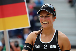 13.07.2014, Beach Village, Gstaad, SUI, FIVB Beach Volleyball Grand Slam Gstaad, im Bild Ilka Semmler (GER) // during the FIVB Beach Volleyball Grand Slam Gstaad at the Beach Village in Gstaad, Switzerland on 2014/07/13. EXPA Pictures © 2014, PhotoCredit: EXPA/ Freshfocus/ Claude Diderich<br /> <br /> *****ATTENTION - for AUT, SLO, CRO, SRB, BIH, MAZ only*****