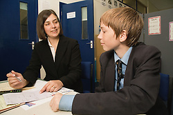 Teacher having a one to one session with a secondary school pupil,