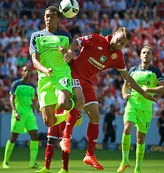 MAINZ, GERMANY - Sunday, August 7, 2016: Liverpool's Trent Alexander-Arnold in action against FSV Mainz 05's Daniel Brosinski during a pre-season friendly match at the Opel Arena. (Pic by David Rawcliffe/Propaganda)