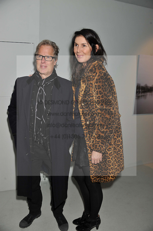 ANNABELLE BROOKS and JAMES DEARDEN at a private view of Bill Wyman - Reworked held at the Rook & Raven Gallery, 7 Rathbone Place, London W1 on 26th February 2013.