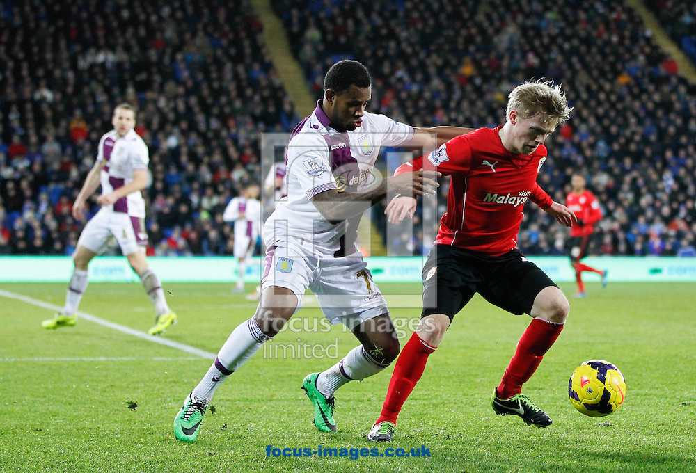 Mats Moller Daehli of Cardiff City and Leandro Bacuna of Aston Villa during the Barclays Premier League match at the Cardiff City Stadium, Cardiff<br /> Picture by Mike  Griffiths/Focus Images Ltd +44 7766 223933<br /> 11/02/2014