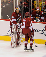 May 13, 2012; Glendale, AZ, USA; Phoenix Coyotes goalie Mike Smith (41) talks with defenseman Keith Yandle (3) in the first period of game one of the Western Conference finals of the 2012 Stanley Cup Playoffs at Jobing.com Arena.  Mandatory Credit: Jennifer Stewart-US PRESSWIRE.