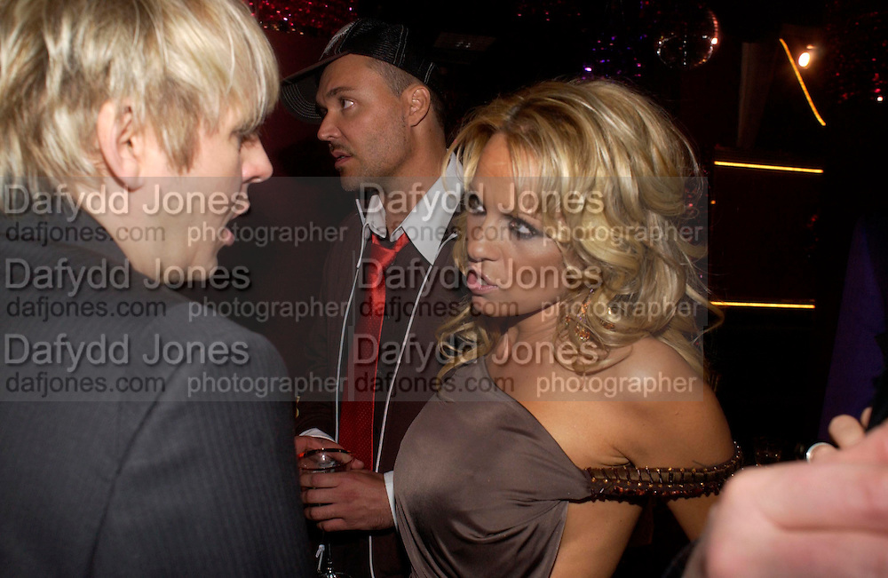 Nick Rhodes,  David LaChapelle and Pamela Anderson. Selfridges Las Vegas dinner hosted by  hon Galen , Hillary Weston and Allanah Weston. Selfridges Oxford St. 20 April 2005. ONE TIME USE ONLY - DO NOT ARCHIVE  © Copyright Photograph by Dafydd Jones 66 Stockwell Park Rd. London SW9 0DA Tel 020 7733 0108 www.dafjones.com