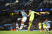 Dinamo Zagreb defender Dino Peric (55) heads clear from Manchester City midfielder Rodri (16) during the Champions League match between Manchester City and Dinamo Zagreb at the Etihad Stadium, Manchester, England on 1 October 2019.
