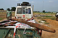 Deminers from Mines Advisory Group (MAG) recover a BM-1 Katyusha rocket as they clear an area around a former military barracks and weapons store used by northern government forces during Sudan's civil war. The building is next to an open area near the John Garang memorial where Independence ceremonies will be held on July 9th, 2011. The area is heavily contaminated with unexploded ordinance (UXO). The Government of South Sudan asked MAG to help SPLA deminers clear the area before the independance celebrations..Juba, South Sudan. 05/07/2011..Photo © J.B. Russell