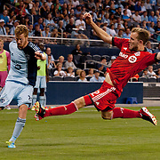 Sporting KC's Oriol Rosell 20 attempts a cross as Toronto FC's Jeremy Brockie 22 tries to block it at Sporting Park, Kansas City, KS.