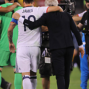 EAST RUTHERFORD, NEW JERSEY - JUNE 17: James Rodriguez #10 of Colombia celebrates victory with Head Coach José Pékerman during the Colombia Vs Peru Quarterfinal match of the Copa America Centenario USA 2016 Tournament at MetLife Stadium on June 17, 2016 in East Rutherford, New Jersey. (Photo by Tim Clayton/Corbis via Getty Images)