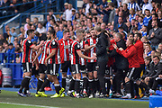 Sheffield United striker Leon Clarke (9) celebrates with the bench after scoring a goal 0-2 during the EFL Sky Bet Championship match between Sheffield Wednesday and Sheffield Utd at Hillsborough, Sheffield, England on 24 September 2017. Photo by Adam Rivers.