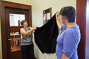 Austa Falconer, left, removes the cover to the award plaque with the help of 2014 MUSD Teacher of the Year Oona Cadorin during the Rotary Club Leo B. Murphy Award for MUSD Teacher of the Year ceremony at the Milpitas Public Library in Milpitas, California, on August 31, 2015. (Stan Olszewski/SOSKIphoto)
