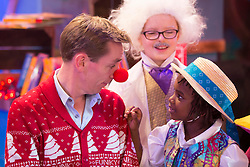 **Embargoed untill 6am Friday 28th November** Repro Free: 27/11/2014 Ryan Tubridy is pictured with Noah Oglesby (7) from Carlow revealing the set for this years The Late Late Toy Show - and it promises to be Truly Scrumptious! The theme of this year's show is based on the iconic musical film Chitty Chitty Bang Bang with the opening act to include a performance of a much-loved song from the film with Ryan taking part in the performance. Picture Andres Poveda