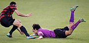 Stanford goal keeper Andrew Epstein, right, slides on the turf as he celebrates blocking a penalty kick at the end of regulation to defeat Akron 8-7 in a NCAA College Cup soccer match, Friday, Dec. 11, 2015, in Kansas City, Kan. (AP Photo/Colin E. Braley)
