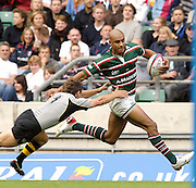 Twickenham, GREAT BRITAIN,  Leicester Tigers, Tom VANDELL'S, strength, carries him through,  Wasps, Simon AMOR'S, flying tackle as he goes in for a try, as the Tigers go down to London Wasps in the final of the 'Coral Middlesex Sevens' tornment at the RFU Stadium Twickenham on Saturday 12.08.2006. Rugby, Final, and presention London Wasps, [winners] vs Leicester Tigers.  Photo, Peter Spurrier, Tel +44 7973 819 551, email images@intersport-images.com...