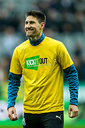 Federico Fernandez (#18) of Newcastle United wearing a 'Kick It Out' campaign t-shirt during the warm-up ahead of the Premier League match between Newcastle United and Crystal Palace at St. James's Park, Newcastle, England on 6 April 2019.