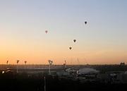 AUSTRALIA - MELBOURNE  Hot air balloons drift across the sky above Melbourne Cricket Ground (MCG) during sunrise at dawn. 07/01/2010. STEPHEN SIMPSON...