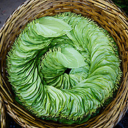 Neatly arranged, betel leaf; for chewing with nut and lime ( and red teeth )