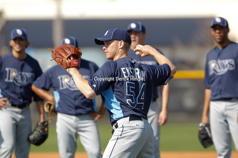 February 20, 2011; Port Charlotte, FL, USA; Tampa Bay Rays relief pitcher Mike Ekstrom (54) throws in a drill as teammates watch during spring training at Charlotte Sports Park.  Mandatory Credit: Derick E. Hingle