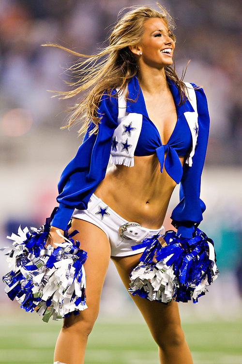 ARLINGTON, TX - NOVEMBER 24:   Dallas Cowboy Cheerleader performs during a game against the Miami Dolphins at Cowboys Stadium on November 24, 2011 in Arlington, Texas.  The Cowboys defeated the Dolphins  20 to 19.  (Photo by Wesley Hitt/Getty Images) *** Local Caption ***