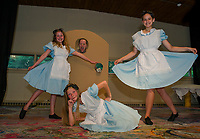 """SKYT's (Streetcar Kids Youth Theater) production of Alice in Wonderland will feature three """"Alice's"""" in the cast played by Ella Denney, Isabella Cottrell and Zoe Lehneman shown here with """"Doorknob"""" Savannah Shepard during dress rehearsal Monday evening.  (Karen Bobotas/for the Laconia Daily Sun)"""