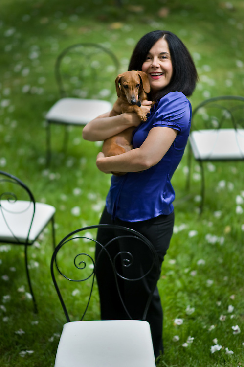 """Jamie Jones with her dog Peabody in their backyard. She loves her dog Peabody and the two of them together would reveal the real warmth she possesses. Local actress Jamie Jones who is starring in the new Cosmo Cabaret production of """"Shear Madness"""" opening June 2. The elegant Jones is considered the queen of local actresses and she has performed at all the professional theaters in town."""