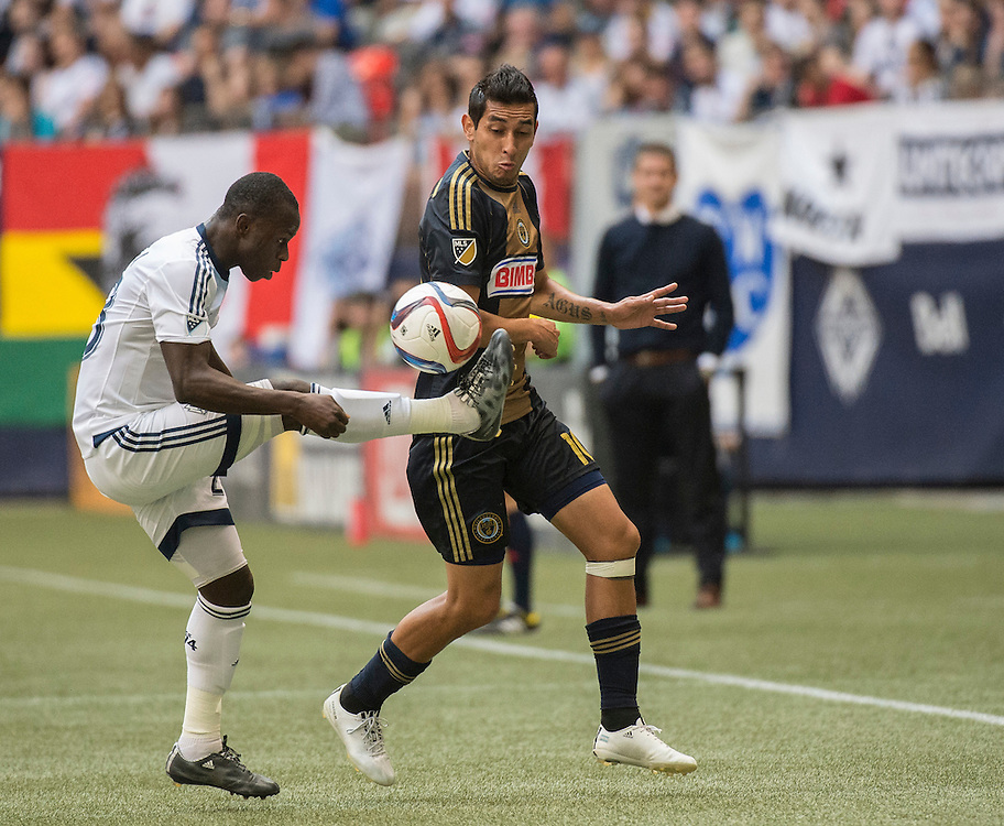 MLS Soccer- Vancouver Whitecaps FC vs. Philadelphia Union at BC Place Stadium in Vancouver: Vancouver Whitecaps Kekuta Manneh (left) and Cristian Maidana of Philadelphia Union.