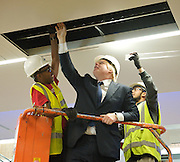 Boris Johnson <br /> The Mayor of London <br /> visits the Westfield Stratford Shopping development in Stratford, London, Great Britain <br /> 4th July 2011 <br /> Press Conference <br /> <br /> Boris Johnson <br /> with local apprentices<br /> Solomon Abraham (27) electrician<br /> Afzal Uddin (18) shop fitter<br /> <br /> Photograph by Elliott Franks