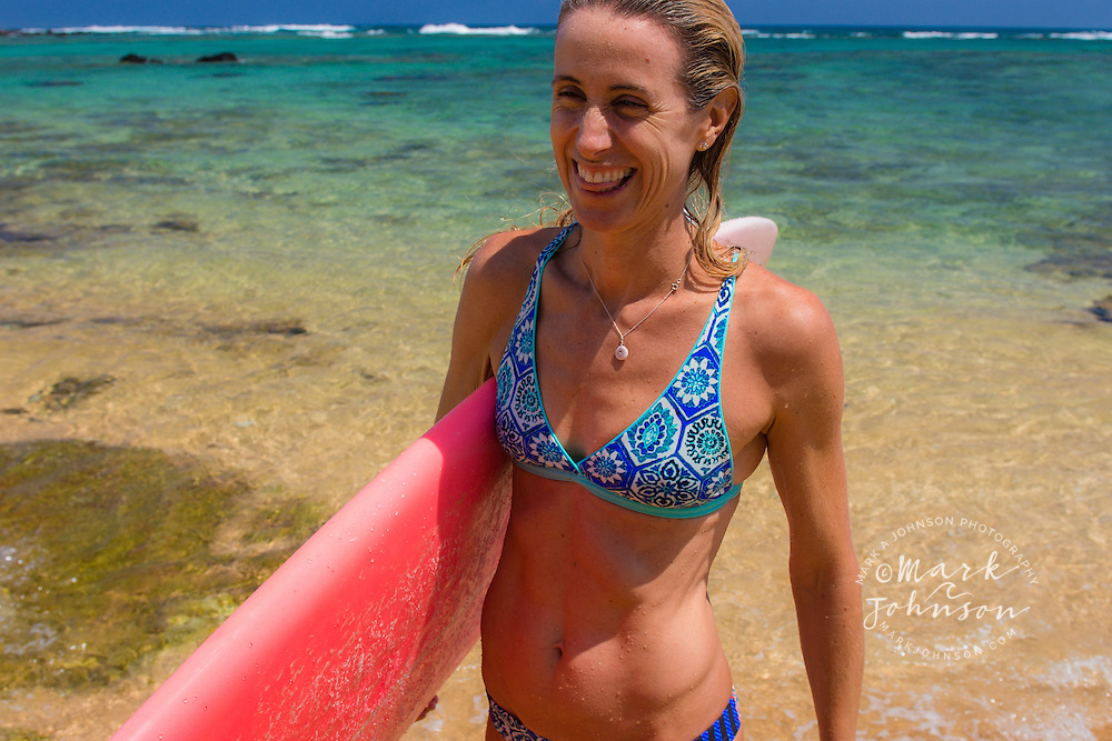 Woman surfer on the beach, Hawaii