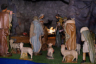 Though the display is created the week following Thanksgiving, the baby Jesus (center) is added on December 24th to the large historic nativity at St. Mary Catholic Church in Dayton, Tuesday, December 27, 2011.  The church spends about 120 person-hours creating the nativity.  For scale, the figure on the left is about the size of a child.